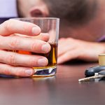 Shot of Liquor Next to Car Keys