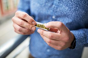 Person Rolling a Marijuana Joint