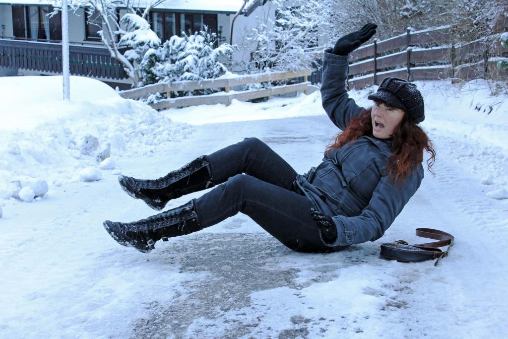 Image of a Temecula woman who has slipped and fallen outside of her home due to a lack of safety measures and her failure to promptly clear her walkway of snow.