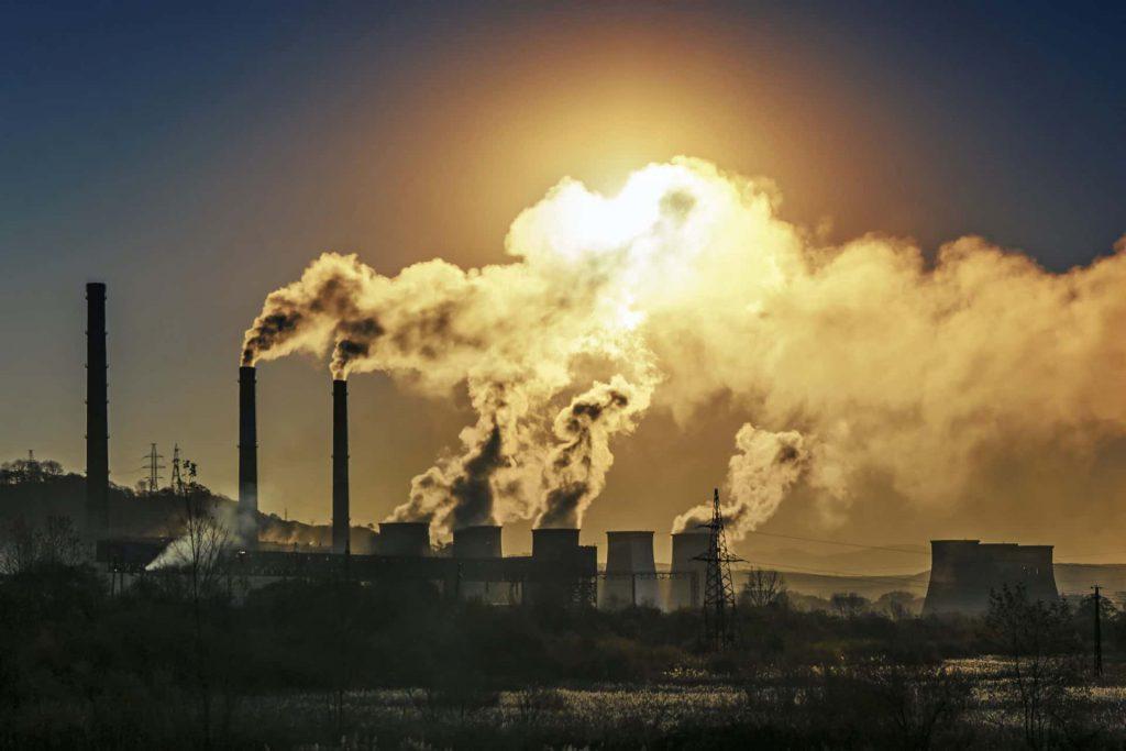 Image of smokestacks emitting air pollutants
