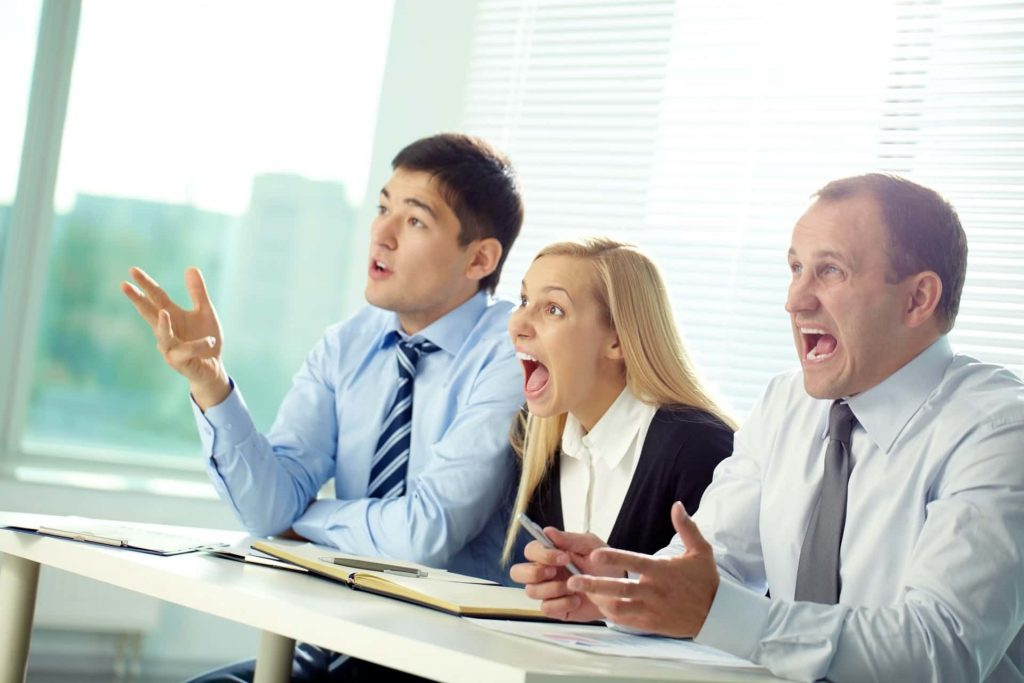 Image of attorneys who are absolutely shocked that a Corona billboard case racked up over $1 million in damages.