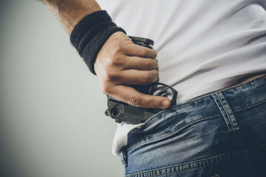 Image of a man with a concealed gun