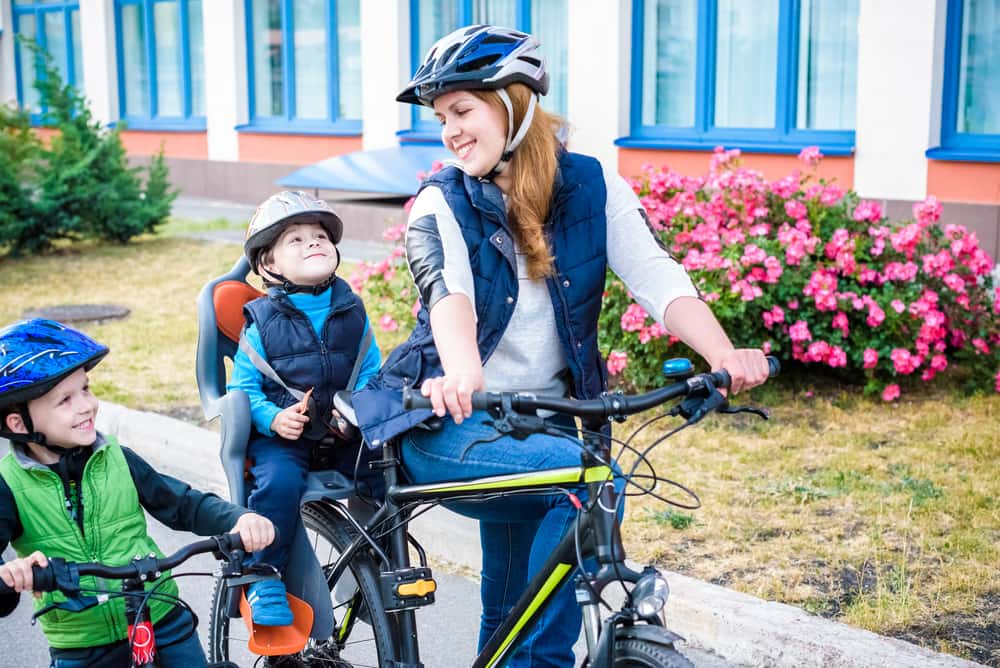 Image of a mother with her two children on bicycles
