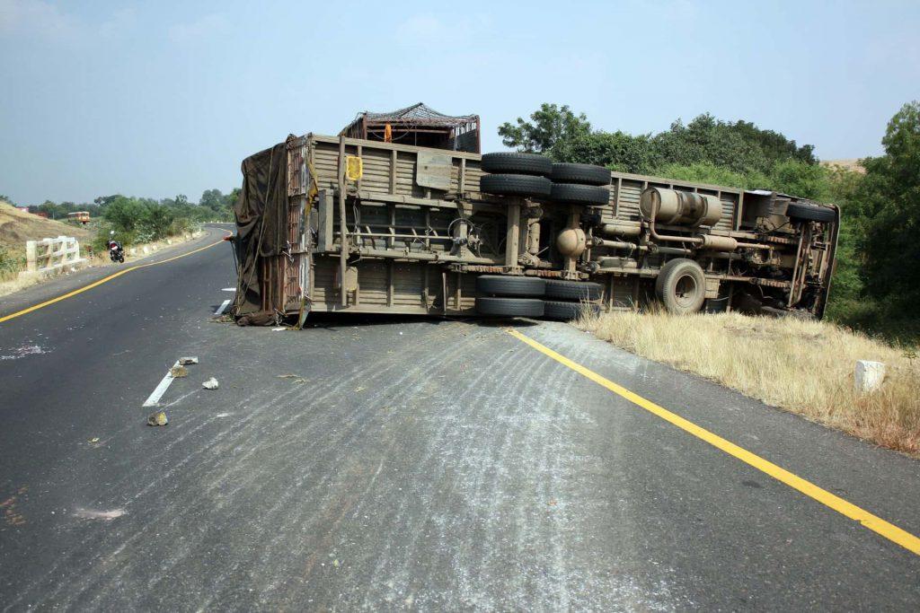 Flipped semi truck