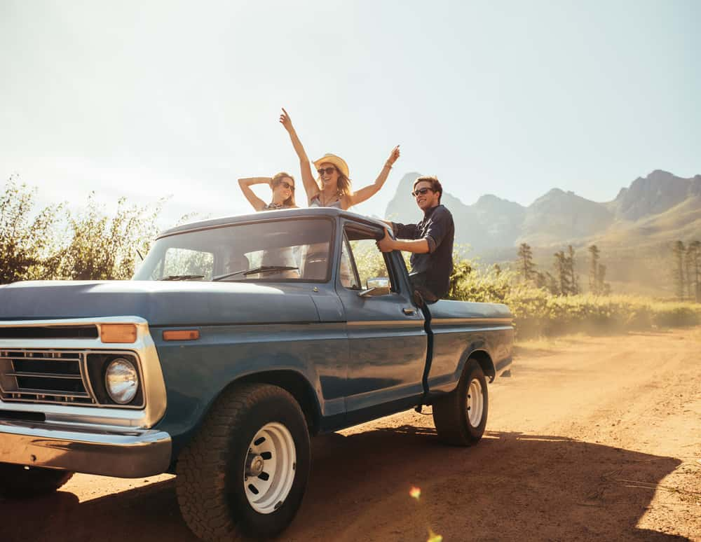 Image of teenagers dancing in the bed of a pickup truck